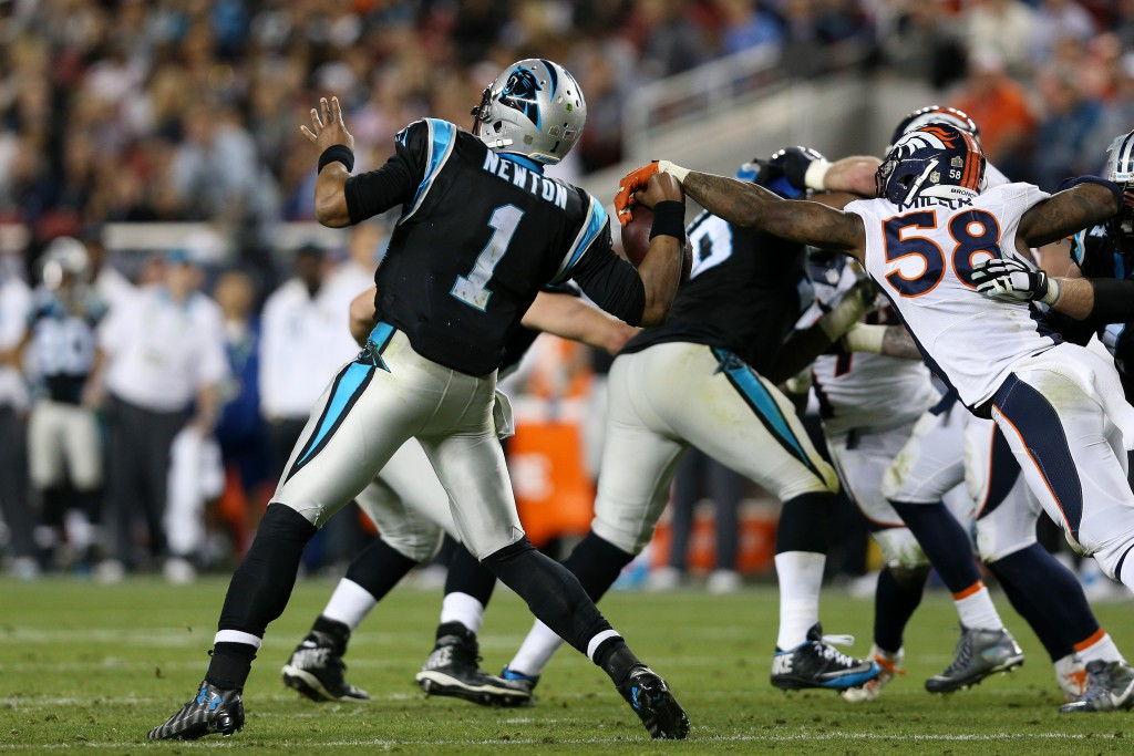 SANTA CLARA, CA - FEBRUARY 07: Von Miller #58 of the Denver Broncos strips the ball from Cam Newton #1 of the Carolina Panthers in the fourth quarter during Super Bowl 50 at Levi's Stadium on February 7, 2016 in Santa Clara, California. (Photo by Patrick Smith/Getty Images)